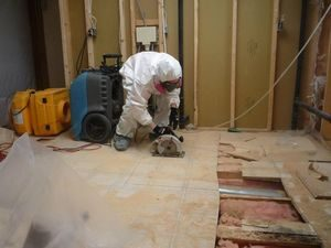 Water-Damage-Restoration-Opening-Floor-Boards-Mold-Removal