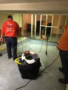 Water-Damage-Restoration-Technicians-Cleaning-Carpet-After-A-Flood