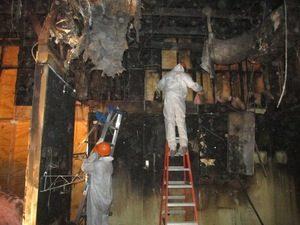Fire Damage Restoration Technicians Inspecting Water Leaks